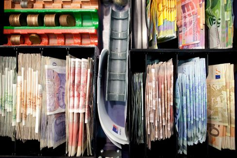 Currency Banknotes Sit in a Cash Register at a Travelex Store