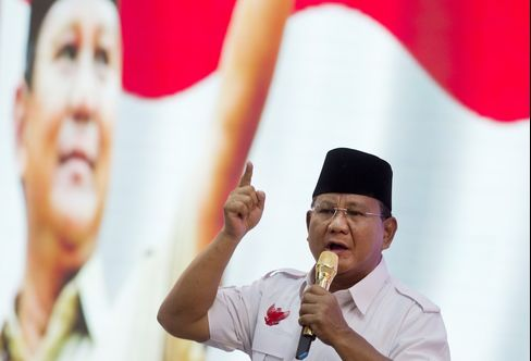 Prabowo Subianto, Indonesian presidential candidate Prabowo delivers his response during the third presidential debate in Jakarta, on June 22, 2014. Bankrolled by his tycoon brother, and with the support of allies including Suharto's old party, Prabowo, 62, has made no bones about his desire to roll back democratization and reinstate the supremacy of the president. Photographer: Rome Gacad/AFP/Getty Images