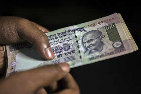 Indian Rupee Plunges Past 60 to Record Low as Dollar Strengthens