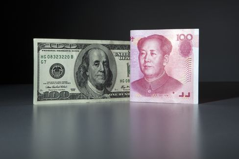 A Chinese 100 yuan and U.S. 100 dollar bank note