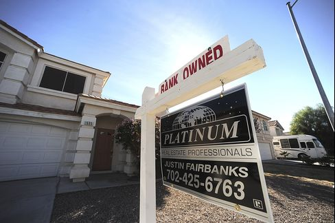 A Bank Owned Sign Hangs Outside a Home for Sale in Las Vegas