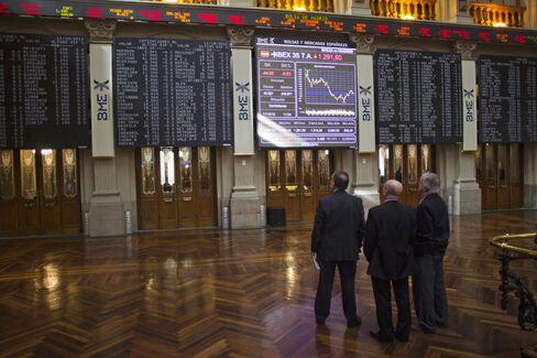 Stocks Slide on Earnings
