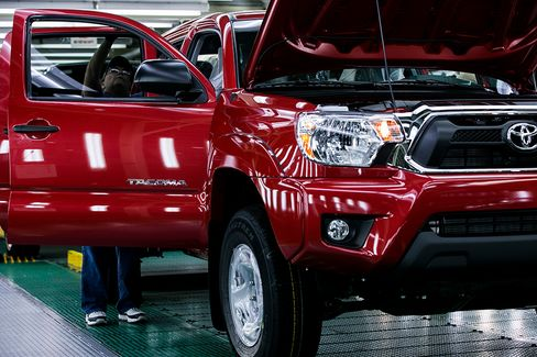 Toyota Buying Back Stock for First Time Since 2009 as Cash Grows