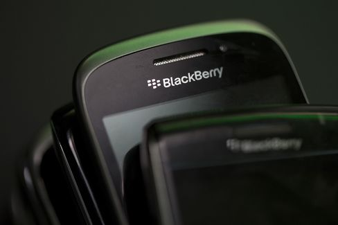 The BlackBerry Logo Sits on a BlackBerry Smartphone