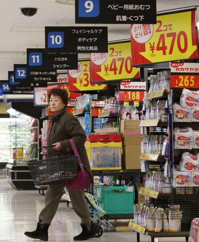 Signage displays sale prices as a customer shops at a Seiyu GK supermarket in Tokyo, Japan. Photographer: Tomohiro Ohsumi/Bloomberg