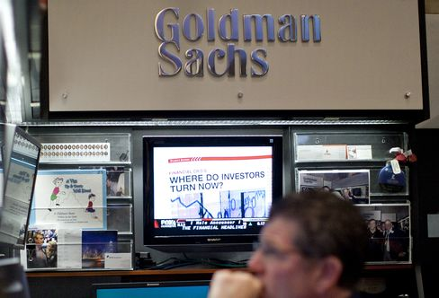Goldman Sachs Group Inc., the New York-based bank that makes most of its money from trading and set a Wall Street pay record in 2007, slashed average compensation 26 percent in the first nine months. Photographer: Andrew Harrer/Bloomberg