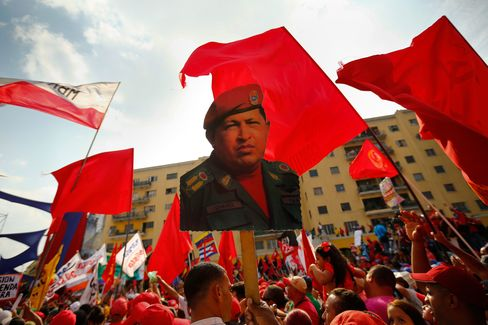 Late President Chavez is still celebrated by crowds, even as the economy slides into chaos. Photographer: Jorge Silva/Landov