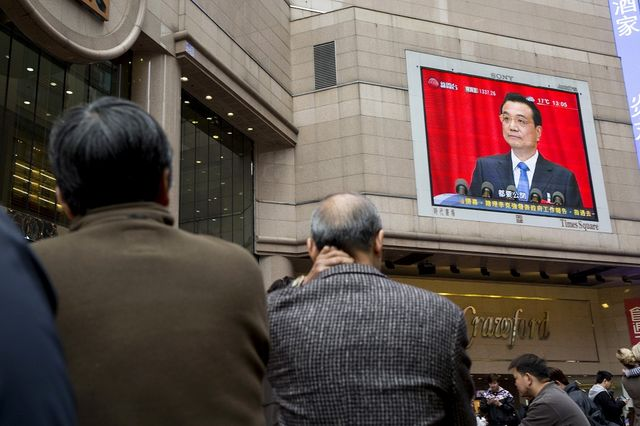 A monitor showing coverage of Li Keqiang, China's premier, at the opening session of the National People's Congress (NPC) is displayed in the Causeway Bay district of Hong Kong, China, on Wednesday, March 5, 2014. Photographer: Brent Lewin/Bloomberg