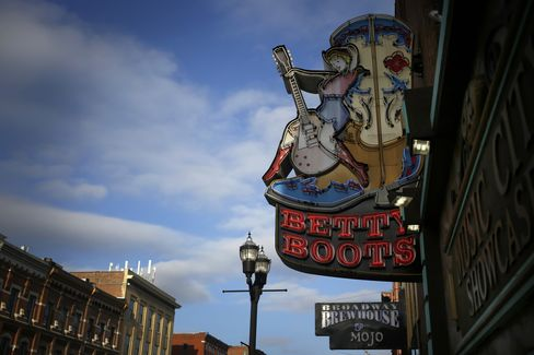 A sign for Betty Boots hangs above Broadway, which is lined with honky-tonks and is the center of nightlife in downtown Nashville, Tennessee. Photographer: Luke Sharrett/Bloomberg