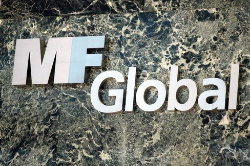 MF Global listed $39.7 billion in debt and $41 billion in assets and said it has about $26 million in cash in its Oct. 31 filing. Photographer: Stephen Yang/Bloomberg