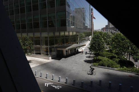 A cyclist passes 200 West Street, which houses the headquarters of Goldman Sachs, in New York. Photographer: Scott Eells/Bloomberg