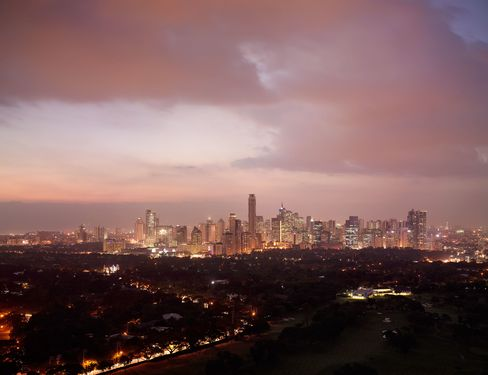 Manila is the capital of a country blessed by an economic resurgence -- and yet afflicted still by misery.  Photograph: Virgile Simon Bertrand/Bloomberg Markets