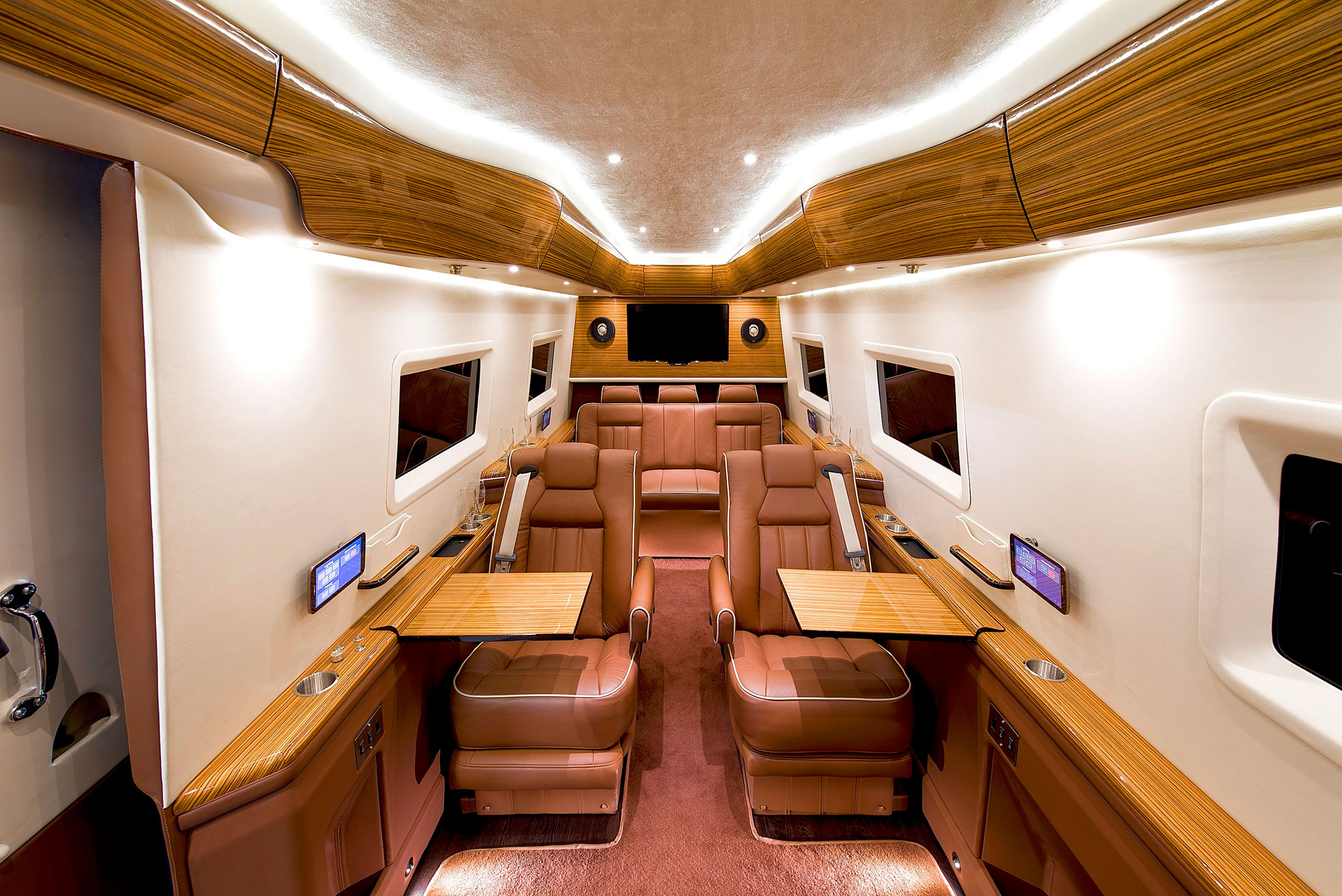 These insane pimped out vans for ceos redefine commuting for Mercedes benz sprinter custom interiors