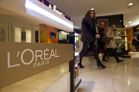 Shoppers Pass a L'Oreal SA Sales Counter