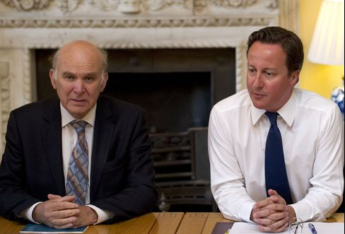 U.K. Prime Minister Cameron and Business Secretary Cable