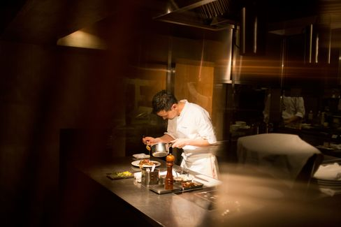 Chef Shinobu Namae at one-Michelin-starred L'Effervescence displays his mastery of French techniques.  Photograph: Jeff Mermelstein/Bloomberg Pursuits