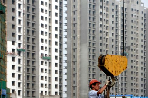 China Builders Plunge in Hong Kong on Trust Financing Report