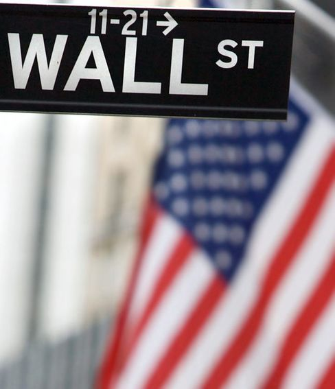 Wall Street sign near the New York Stock Exchange in New York. Photographer: Jin Lee/Bloomberg News
