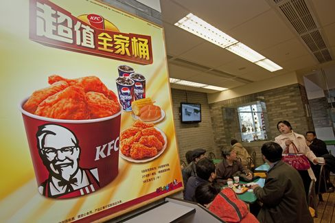 Customers eat at a KFC restaurant in Beijing. Photographer: Nelson Ching/Bloomberg