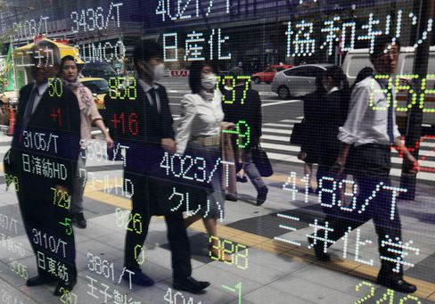Asian Stocks Snap Two-Day Rally on Greece Exit Risk, Japan Trade