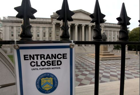 A closed sign hangs at the entrance to the U.S. Treasury building in Washington D.C. on Oct. 3, 2013. Treasury Secretary Jacob J. Lew has said the government will have only $30 billion of cash left by Oct. 17 to meet its commitments. Photographer: Julia Schmalz/Bloomberg