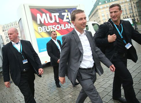 Bernd Lucke, head of the Alternative fuer Deutschland party (AfD), center, heads for a political rally during the European parliamentary elections last month. Photographer: Sean Gallup/Getty Images