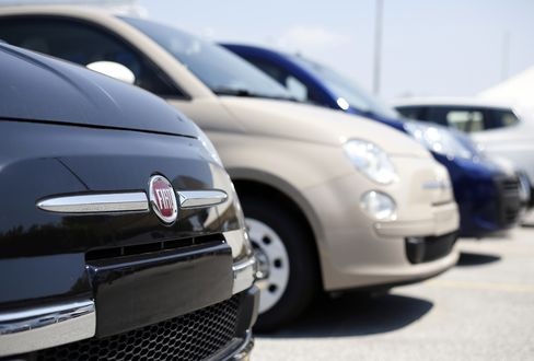 Fiat 500 Automobiles Sit at a Dealership in Rome
