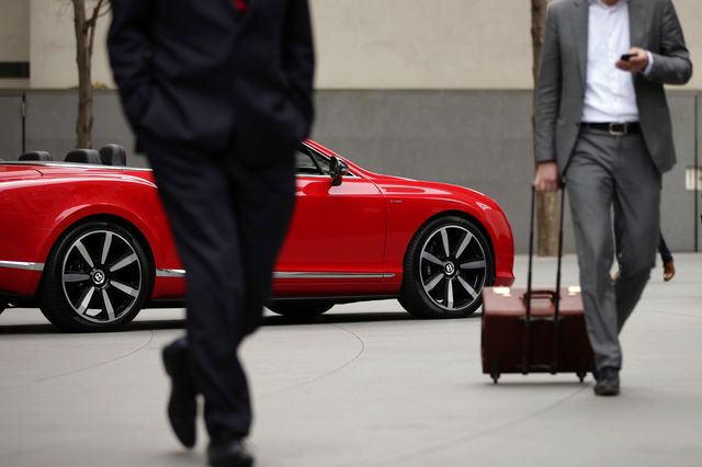 Is that a suitcase full of money or are you just pleased to be here? Photographer:Matthew Lloyd/Bloomberg