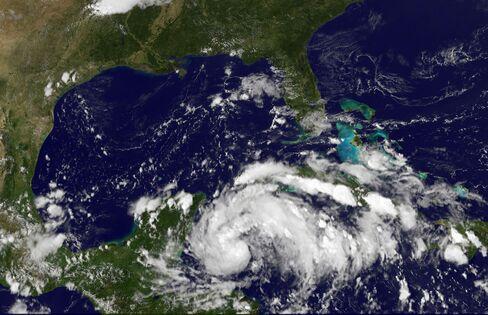 Tropical Storm Threatens Yucatan Resorts, Oil Wells