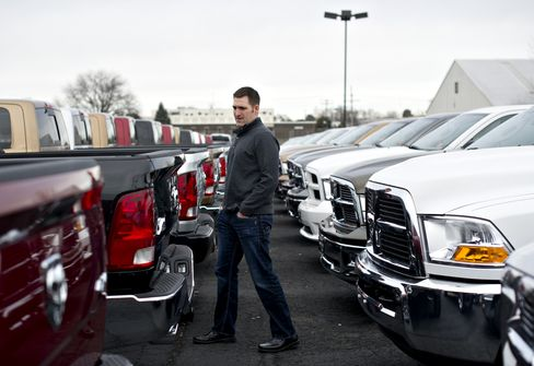 Joe DeLucia with a Dodge Ram pickup truck in Peoria, Illinois. Photographer: Daniel Acker/Bloomberg