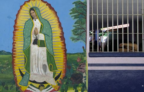 A religious image is painted on the wall of a penitentiary in Sinaloa state, Mexico. In his home state of Sinaloa, the cult-like worship of drug trafficker Joaquin Guzman helped purchase devotion that allowed him to move more freely than commonly thought during the 13 years since his prison escape. Photographer: Alfredo Estrella/AFP via Getty Images
