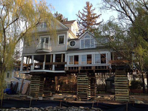 Greenwich Stilt Houses Foreshadow Impact of New U.S. Flood Maps