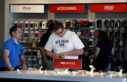 A Customer Browses Phones at a Verizon Communications Store