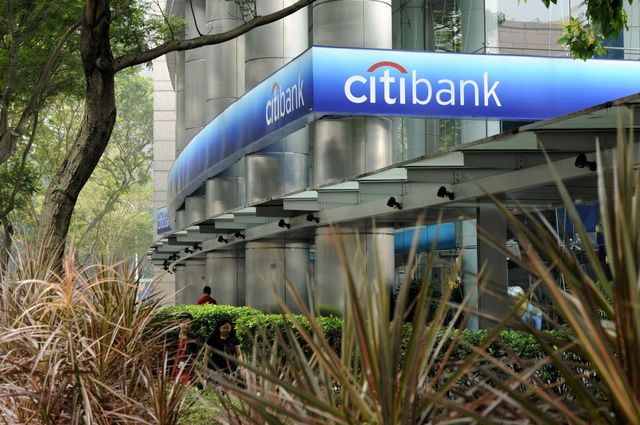 I looked for the most boring possible picture of a bank but then was seduced by this, which is actually sort of intriguing. It's like a Citibank branch lurking behind some vegetation, waiting to pounce. Photographer: Munshi Ahmed/Bloomberg.