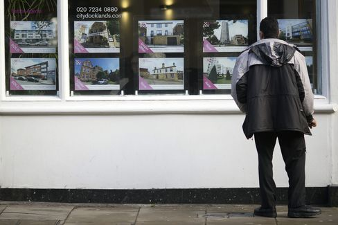 A Pedestrian Looks at the Window Display of an Estate Agents