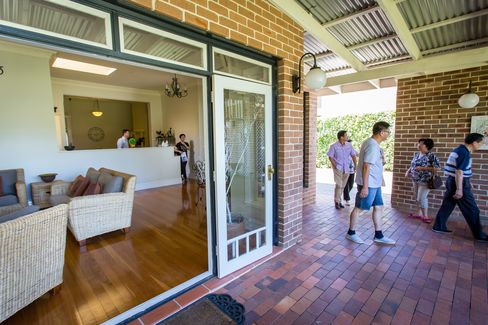 Prospective buyers inspect a house for sale in the suburb of Eastwood in Sydney. Photographer: Ian Waldie/Bloomberg