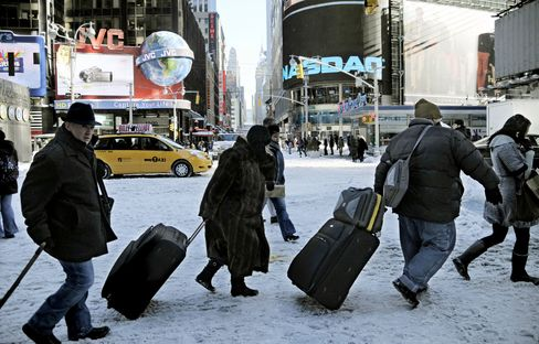 Wind-Driven Snow Blankets East Coast, Shuts Airports