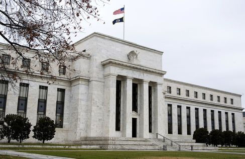 Two Fed Skeptics Say Inflation Underscores Program Risks