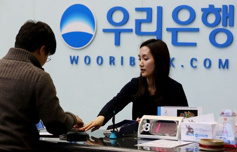 Woori Sale Seen Success at Last on $10.2 Billion Split
