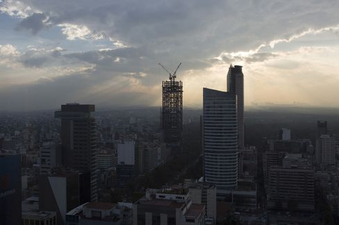 Cranes Stand on the Skyline in Mexico City
