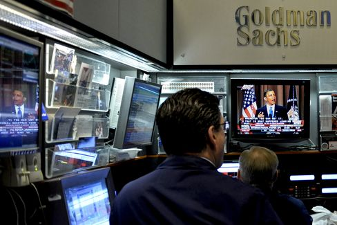 Traders at the Goldman Sachs Group Inc. booth