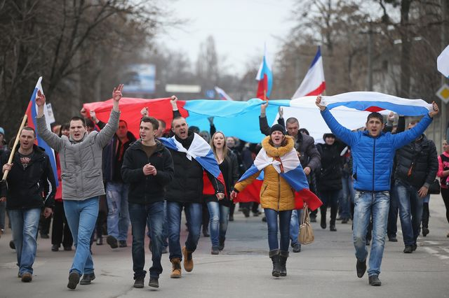 Pro-Russian Ukrainians on the march; they may not want Putin to come to their rescue. Photographer: Sean Gallup/Getty Images