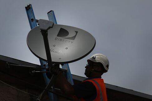 A DirecTV Technician Installs a New Satellite TV Dish