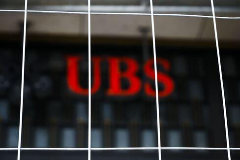 UBS Posts Quarterly Loss on Libor Fine, Reorganization Cost