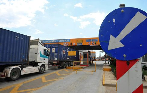 Trucks Deliver Shipping Containers at Thessaloniki Port