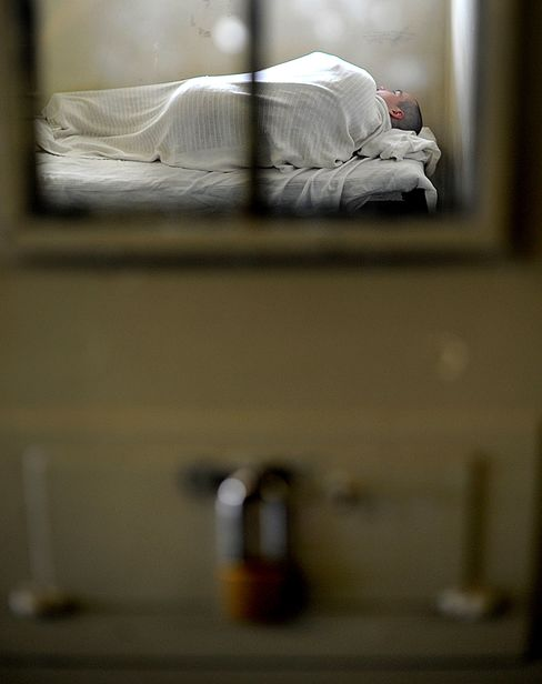 An inmate sleeps in a medical cell at prison in California. Photographer: Noah Berger/Bloomberg