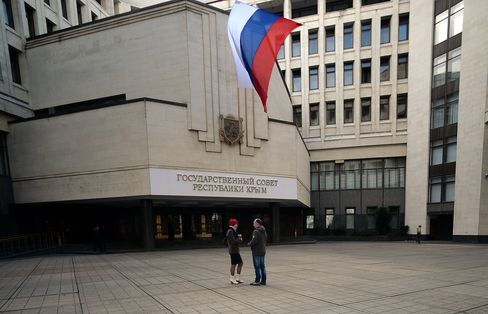 A Russian Flag Flies Outside the Crimean Parliamant Building