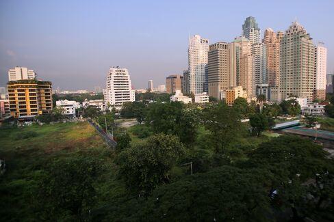 High rise buildings tower over a cleared site along Langsuan Road in Bangkok. Photographer: Dario Pignatelli/Bloomberg