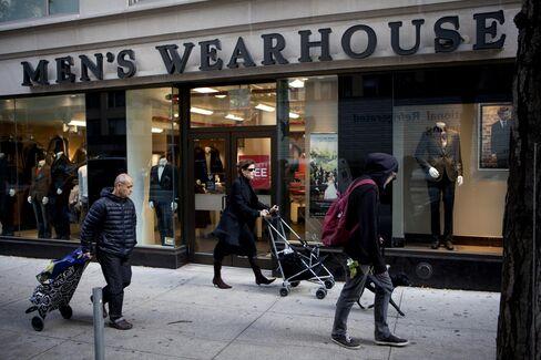 Pedestrian Pass a Men's Wearhouse Inc. Store in New York