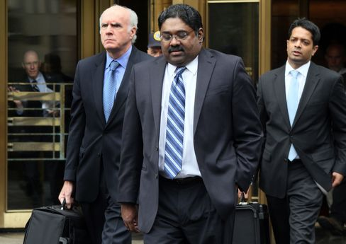 Raj Rajaratman, center, leaves federal district court in New York on Oct, 13, 2011, after being sentenced to 11 years in prison for insider trading. Photographer: Rick Maiman/Bloomberg